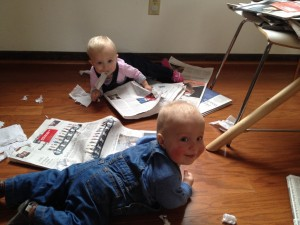 Reading starts early in the Wrage household as books and newspapers nourish the twins!